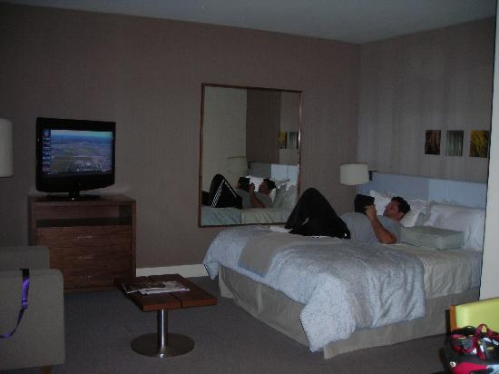 Hotel Vitale, a Joie de Vivre hotel: hubby relaxing on the comfy bed