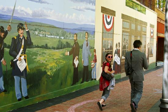 Topeka, KS: Outdoor mural commemorates the Free State Constitution outlawing slavery in Kansas in downtown T