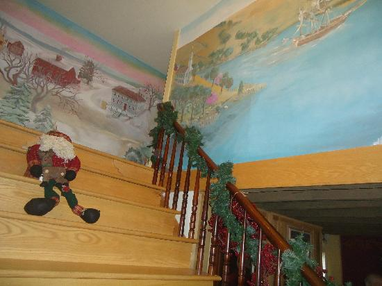 Captain Grant&#39;s, 1754: Hand-painted mural on stairway leading to rooms