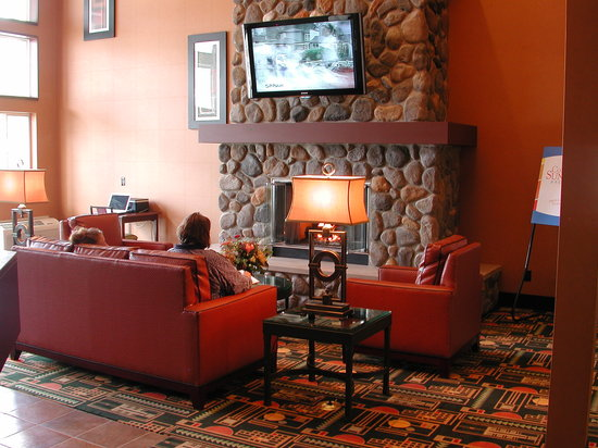 Comfort Inn Traverse City: stay warm by our lobby fireplace