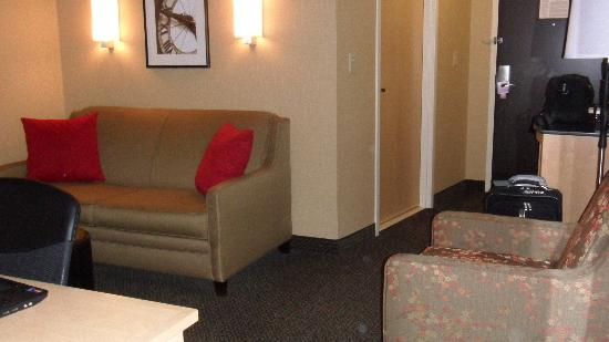 Cambria Suites: couch, chair, micro/frig/coffee maker table