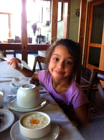 Santiago Hillside Hotel: My daughter enjoying breakfast