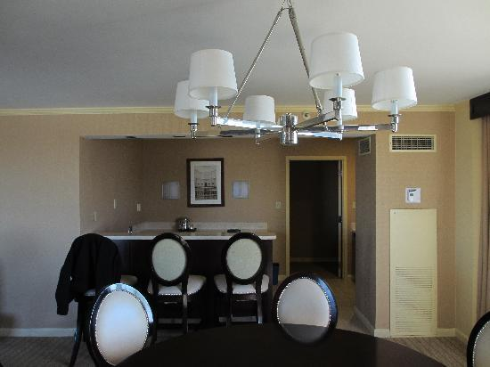 Sheraton Austin at the Capitol: Suite 1600 Living / Dining + Sink & mini-fridge behind the counter