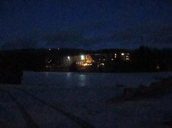 Snow Lake Lodge: the lodge from across the lake at night