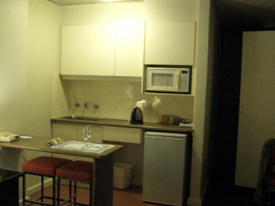 City Limits Serviced Apartments: kitchenette with fridge