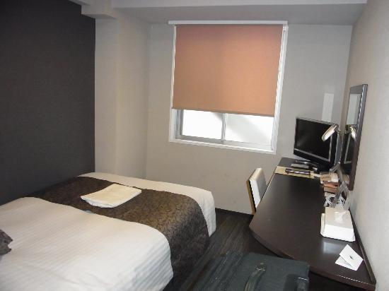 Small room but big enough picture of hotel mystays for Small lounge suites small rooms