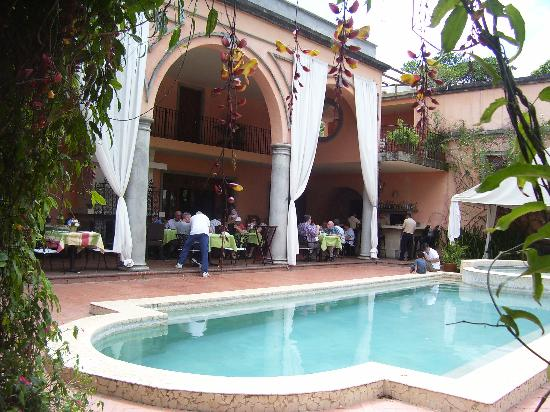 View of the dining area overlooking the pool and gardens - Casa de lourdes ...