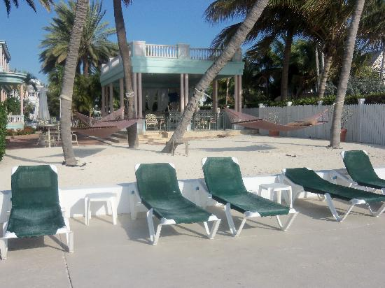 Beach chairs facing the ocean picture of the southernmost house key