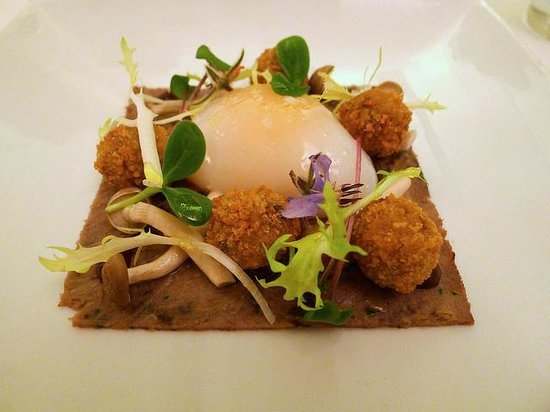 ... Dining Room Photo: Slow cooked duck egg and confit duck leg starter