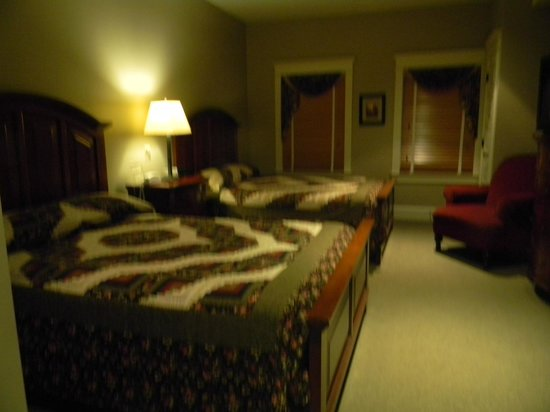 Inn at Kitchen Kettle Village: Handmade Amish quilts on our beds!!! Sorry a little fuzzy.