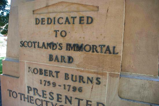 Centenary Place: Dedication at the base of a statue