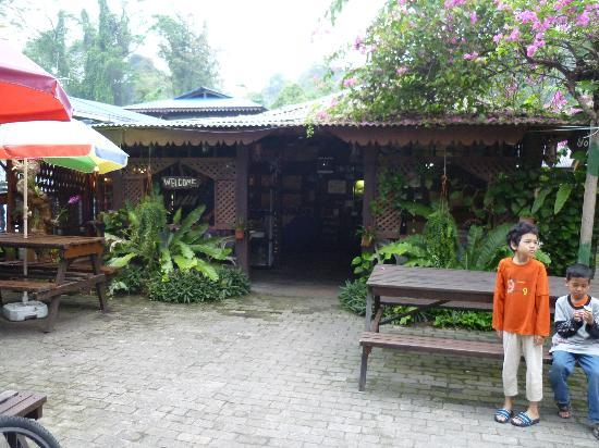 Ombak Inn Resort: one of my kid at front of reception place cum eating place