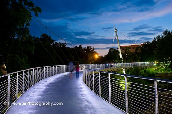 Greenville, SC: Stroll the Liberty Bridge and view the 28 foot waterfalls at sunset