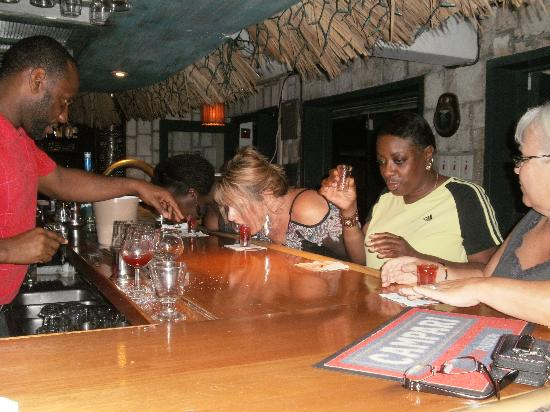Doctors Cave Beach Hotel: kenny telling us how to drink the lollipop shot lol not as easy as u think