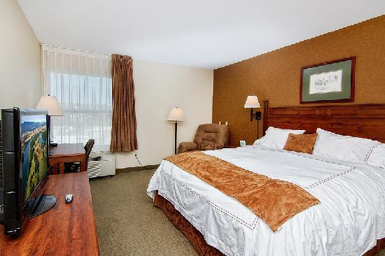 "Boothill Inn & Suites: The bedroom in the suite includes a 37"" flat screen TV"