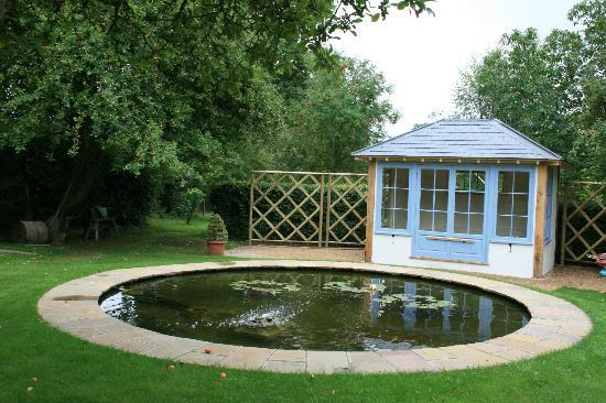Road Green House: Garden pond and summer house