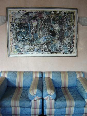 Casa dei Pittori Venice Apartments: Old chairs under original painting
