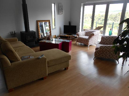 Baystay B&amp;B: Good light, comfortable couch and chairs, tv. A nice place to relax or talk with other guests.