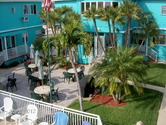 Coral Resort Condominiums: A VIEW OF THE PATIO AREA FROM OUR UPSTAIRS ROOM
