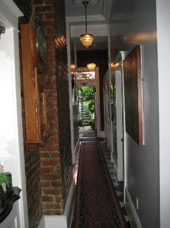 New Orleans Guest House: First floor hallway and doorway to courtyard