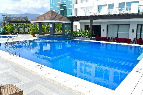 A Small Waterfall On The Side Of The Pool Picture Of Quest Cebu Cebu City Tripadvisor