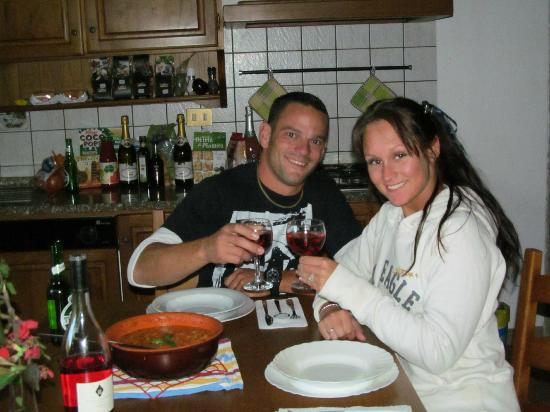 Residence Santa Maria: Us, enjoying the dinner we just made during our Italian Cooking Class, by Laura.