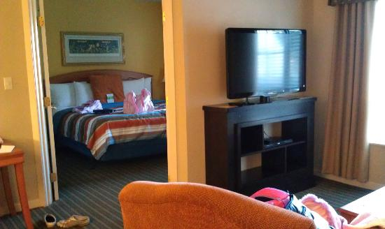 HYATT house Boston/Burlington: Bedroom w/King bed (TV in bedroom as well). Additional TV in sitting area outside.
