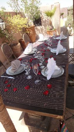 Dar Darma: Table set with rose petals by pool for lunch