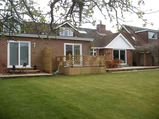 Little Heathers: Garden view showing &#39;Burley&#39; patio