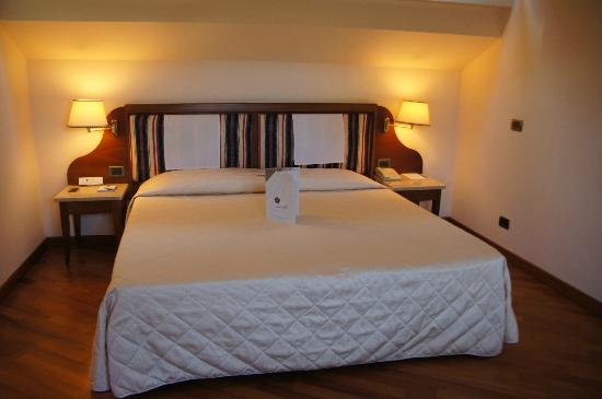 Hotel Laurus al Duomo: March 19, 2012.  Room 8, top floor.  King size bed.  EXTREMELY firm and low.