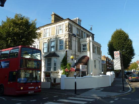 London Guest House: The outside of the hotel with bus 266 in the foreground.