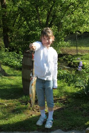 Showing off her big catch picture of english mountain trout farm grill sevierville - Trout farming business family mountains ...