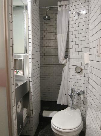 The aircraft style bathroom picture of pod 51 hotel new for Pod style bathroom