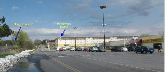 Homewood Suites Ithaca: side view of the hotel adjacent to a small strip of small stores
