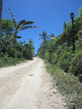   : Treacherous, steep dirt road leading to hotel entrance; ~100 meters long