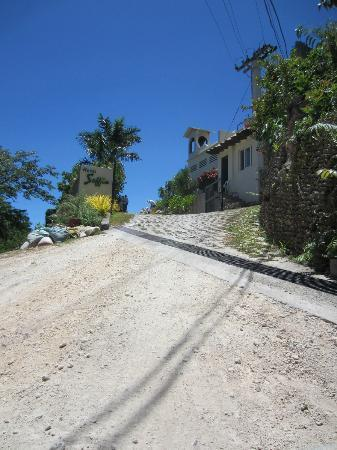   : The entrance to the hotel from a steep dirt road; hope it doesn&#39;t rain during your stay;