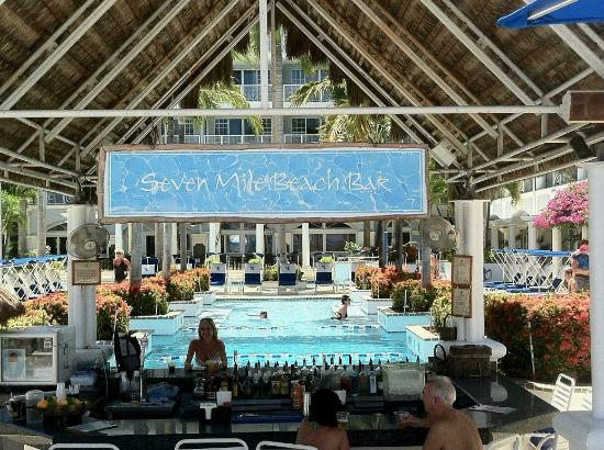 Grand Cayman Beach Suites: The inviting Bar with the hotel pool visible in back