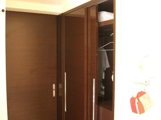 S-aura Hotel: Clothing cabinet accessible from bathroom.