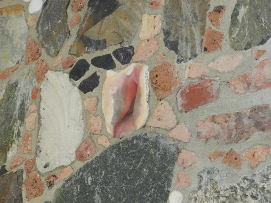 Sea Shore Allure Condominiums: Close up of stone &amp; sea shell wall in master bath