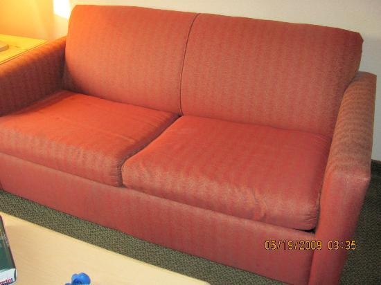 Comfort Suites: couch with depressed cushion