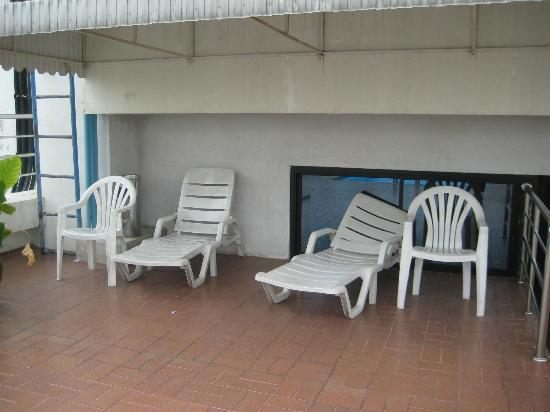 White Palace Bangkok: Broken Chairs by the Pool.