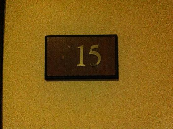 The Pinnacle Hotel & Suites: Standard room before we were upgraded. Look at the room number considering it's a 1 yr old hotel