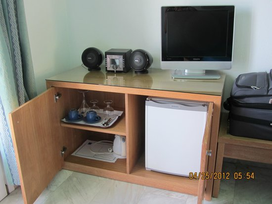 Poseidon Hotel - Suites: TV, stereo, coffee pot, refrig, and glassware