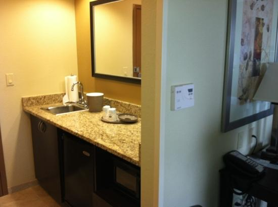 Hampton Inn &amp; Suites Jacksonville - Bartram Park: Kitchenette area with sink and refrigerator. Right as you walk in the door.
