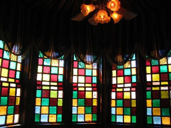 The Empress of Little Rock : Stained glass windows in the card room which is located in the attic.