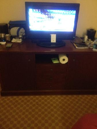 Country Inn & Suites By Carlson, Dothan: entertainment center with refrigerator and microwave hidden away