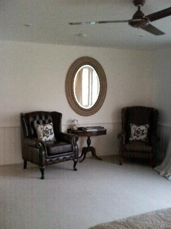 Aylstone Boutique Retreat: The large leather chair and vast mirror
