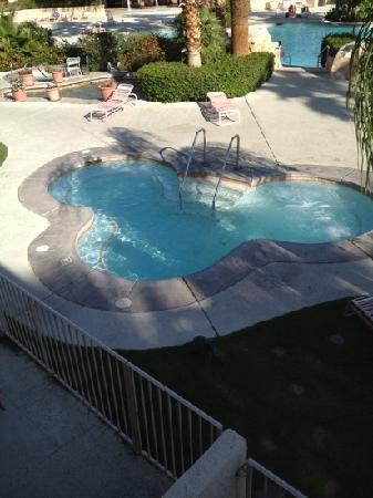 Miracle Springs Hotel and Spa: one of the three large spas with the pool and couple&#39;s spa in the background