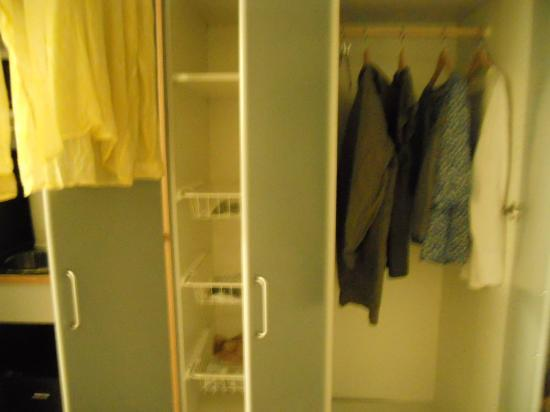 Clarion Collection Hotel Odin: closet area left has shelves/bins and right full rack with iron and board