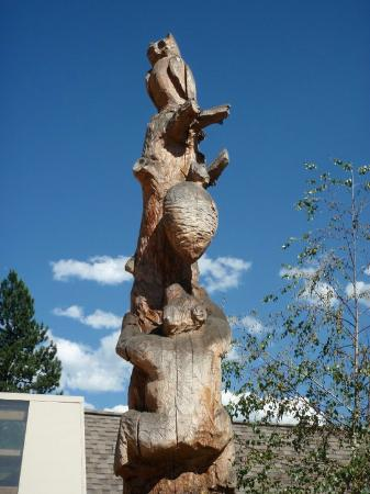 Slocan, : Carved wooden statue